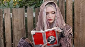 Grimes Photographed Reading Karl Marx Following Split From Elon Musk