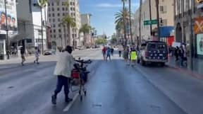 Homeless Man Hilariously Shuts Down Anti-Vax Protester In The Street