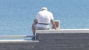 OAP Takes Framed Photo Of Late Wife To See The Sea View Every Day