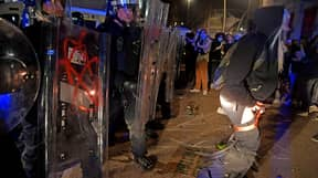 Photos Show Protesters In Bristol 'Defecating' At Feet Of Police During Riots