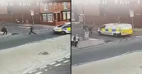 Moment Policeman Is Ran Over By His Own Van While Chasing Down Suspect