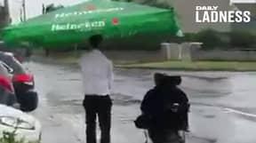 Barman Uses Pub Umbrella To Escort Customer Home In Pouring Rain