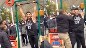 Stall Owner Pulls Contestant Down From Hanging Bar As He's About To Win £100
