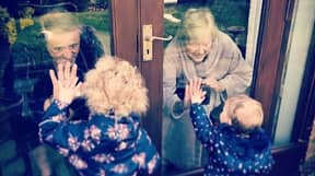 Quarantined Grandparents Embrace Their Great-Grandchildren Through Window Pane