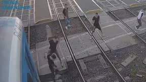 Train Narrowly Misses Group After Huge Brawl Erupts On Railway Tracks