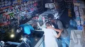 Armed Robber Refuses To Take Cash From Elderly Shopper And Kisses Her On The Head