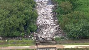Man Walks On River Due To Amount Of Rubbish Accumulated