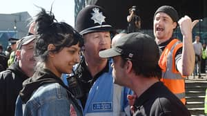 Incredible Picture Of 'Contemptuous' Woman Smiling At EDL Protester Goes Viral