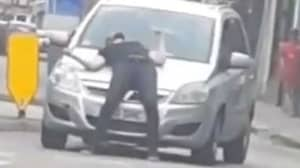 Man Walks In Front Of Car And Slumps To Ground In 'Crash For Cash' Stunt