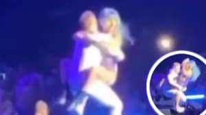Lady Gaga Tumbles Off Stage Dancing And Straddling A Fan