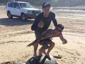 Two Men Could Face A Huge Fine For 'Surfing' Endangered Turtle