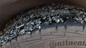 UK Heatwave Melts Road Leaving Woman's Tyres Completely Covered In Tarmac