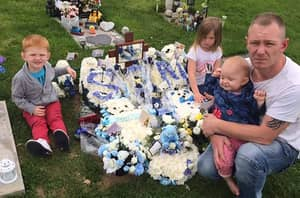 Parents Ordered To Remove A DIY Wooden Headstone From Their Son's Grave