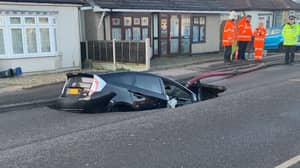 Car Falls Into Huge Sinkhole On Suburban Essex Street