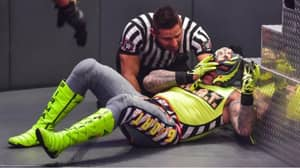 WWE Legend Rey Mysterio Has 'Eye Popped Out' As Opponent Seth Rollins 'Vomits'