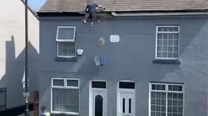 Shocking Moment Man Slips Off Roof 'Trying To Escape Police'