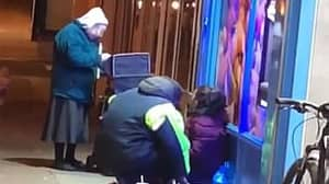 Elderly Woman Hands Out Soup To Homeless People In 3C Temperatures