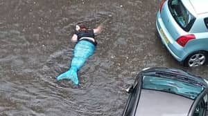 'Mermaid' Spotted Swimming In Flooded Street