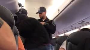 Authorities Drag Doctor Off United Airlines Flight In Shocking Video