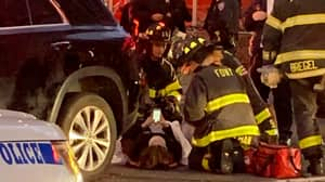 Onlookers Lift Car Off Woman Who Then Goes On Phone While Emergency Services Check Her Over