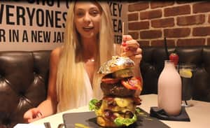 Watch This Woman Smash A 28 Ounce Burger Like It's No Big Deal