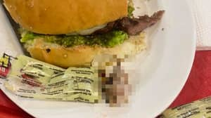 Woman Eating Burger Bites Into Human Finger At Fast Food Restaurant