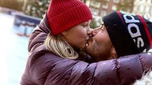Defiant David Beckham Shares Picture Kissing Harper After Being Trolled