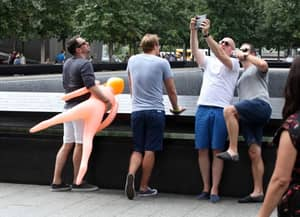Stag-Do Causes Outrage By Taking Selfies With Blow-Up Doll At Ground Zero