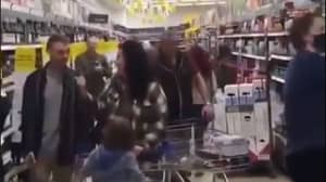 Group Of Anti-Maskers Parade Around Tesco Without Face Coverings