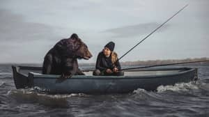 Woman Goes Fishing In Boat With Rescued Brown Bear