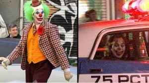 New Photos Emerge Of Joaquin Phoenix In Clown Costume On Set Of 'The Joker'