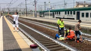 Man Takes Selfie With A Woman Who'd Just Been Hit By A Train