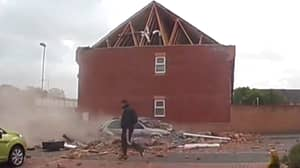 Man Casually Walks Past House As It Crashes Down To The Ground