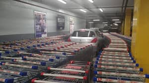 Supermarket Workers Block In Car Parked In Trolley Bay