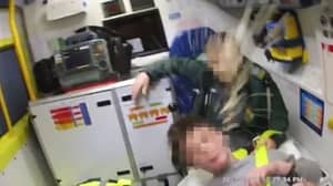 Man Spits At Police Officer 24 Times As They Help Him Into Ambulance