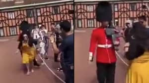 Tourist Shoved By Guardsman After She Stood In His Way During Windsor Castle Drill