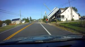Incredible Footage Shows The Moment A Truck Flips And Lands On A House