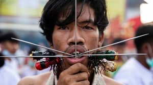 Worshippers Pierce Faces With Metal Spikes And Axes At Thai Vegetarian Festival