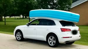 Woman Arrested After Children Spotted In Paddling Pool On Roof Of Moving Car