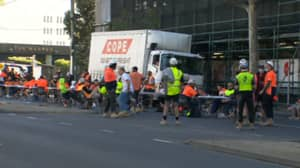 Aussie Tradies Protest Tearoom Ban By Shutting Down Streets To Have Lunch Break