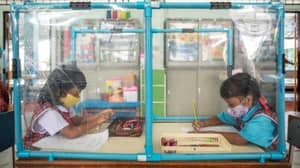 Pupils In Thailand Study Behind Screens To Fight Spread Of Coronavirus