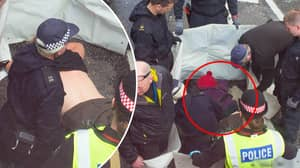 Activist Glues Her Breasts To The Road In London Protest