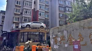 Crane Driver Lifts Up Illegally Parked Car And Dumps It On A Building