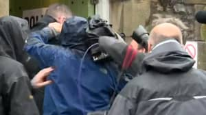 Fight Breaks Out Between Photographer And Cameraman At Polling Booth