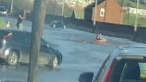 People Are 'Surfing' And 'Canoeing' On A Flooded Road In Leeds
