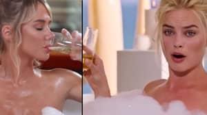 Sara Underwood Recreates Margot Robbie Bath Scene For Stock Trader
