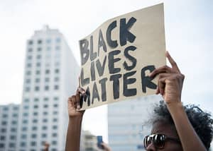 'Iconic' Image Of A Woman Facing Police At 'Black Lives Matter' Protest Goes Viral
