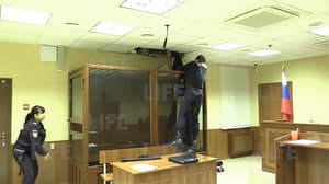 Crazy Moment Russian Killer Tries To Escape Through The Ceiling In Court