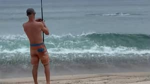 Man Hooks A Great White Shark While Fishing On The Beach
