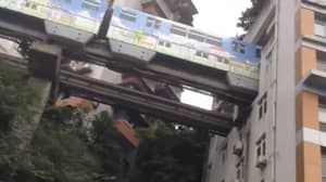 Train Goes Through Flats In China In Clever Design